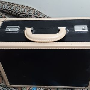 Small suitcase with mirror and pockets inside.